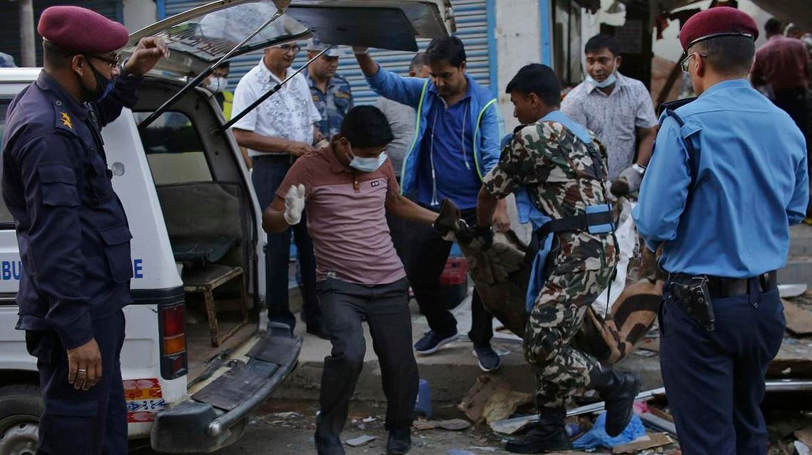 The body of a victim is removed from the site of an explosion in Kathmandu, Nepal, Sunday, May 26, 2019. (AP)