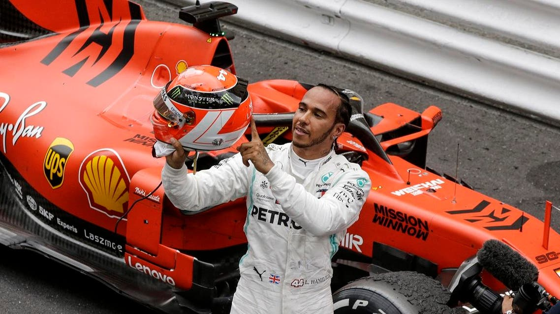 Lewis Hamilton holds his red helmet to tribute Niki Lauda after he won the Monaco Formula One Grand Prix race on May 26, 2019. (AP)