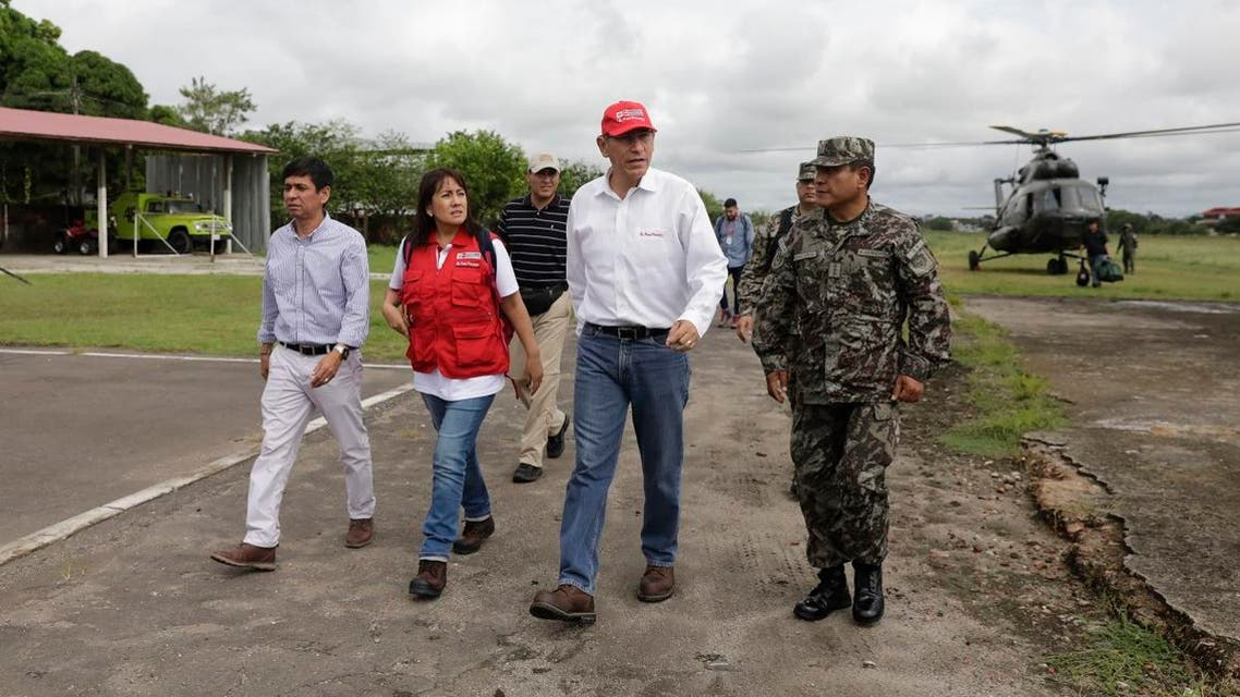 Peru's President Martin Vizcarra, second from right, arrives to the airport after checking earthquake-related damage by air as he arrives to Yurimaguas, Peru, Sunday, May 26, 2019. (AP)