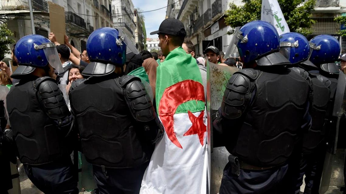 Algerian students take part in a demonstration to mark the 63rd anniversary of National Student Day in the capital Algiers on May 19, 2019. (AFP)