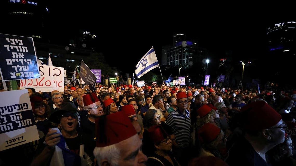 Israelis protest against legislation that could exempt Netanyahu from standing trial. (Reuters)