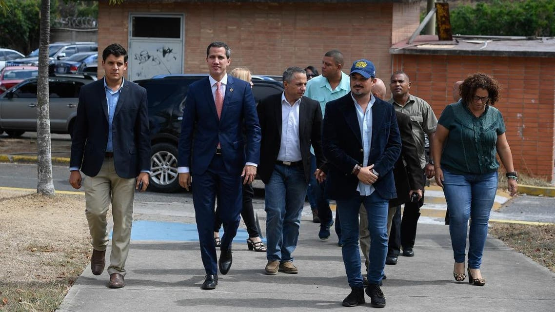 """Venezuelan opposition leader and self-proclaimed interim president Juan Guaido arrives to present his national reconstruction project """"Country Plan"""" at the Andres Bello Catholic University in Caracas. (File photo: AFP)"""
