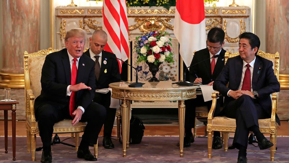 ترمب و رئيس الوزراء الياباني شينزو آبي(فرانس برس)
