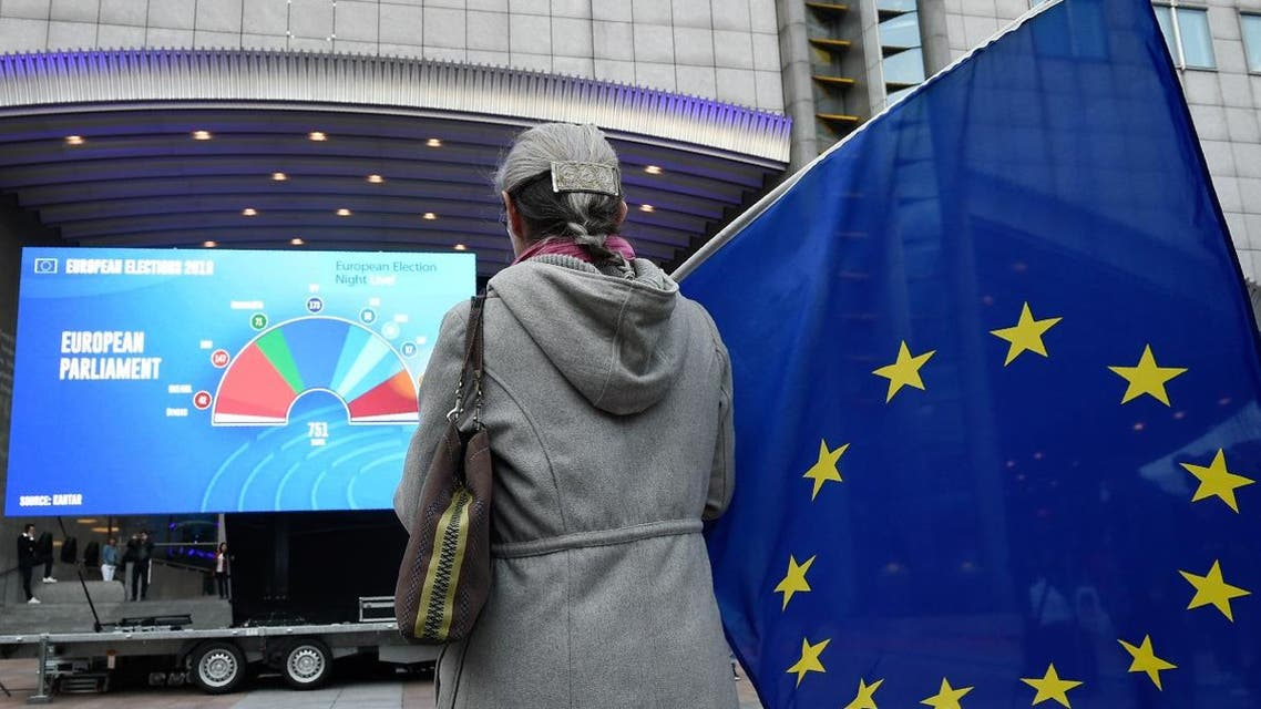A woman holds an European flag outside the European Parliament as people wait for the European elections results in Brussels on May 26, 2019. (AFP)