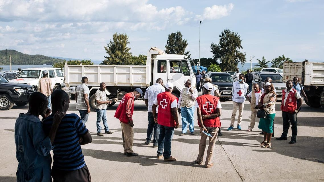 File photo of members of the Congolese Red Cross near trucks carrying the bodies of people drowned in a sinking pirogue. (File photo: AFP)