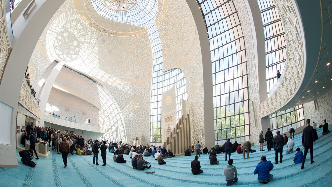 Muslims pray in the central mosque in Cologne-Ehrenfeld, western Germany, on October 3, 2017. (AFP)