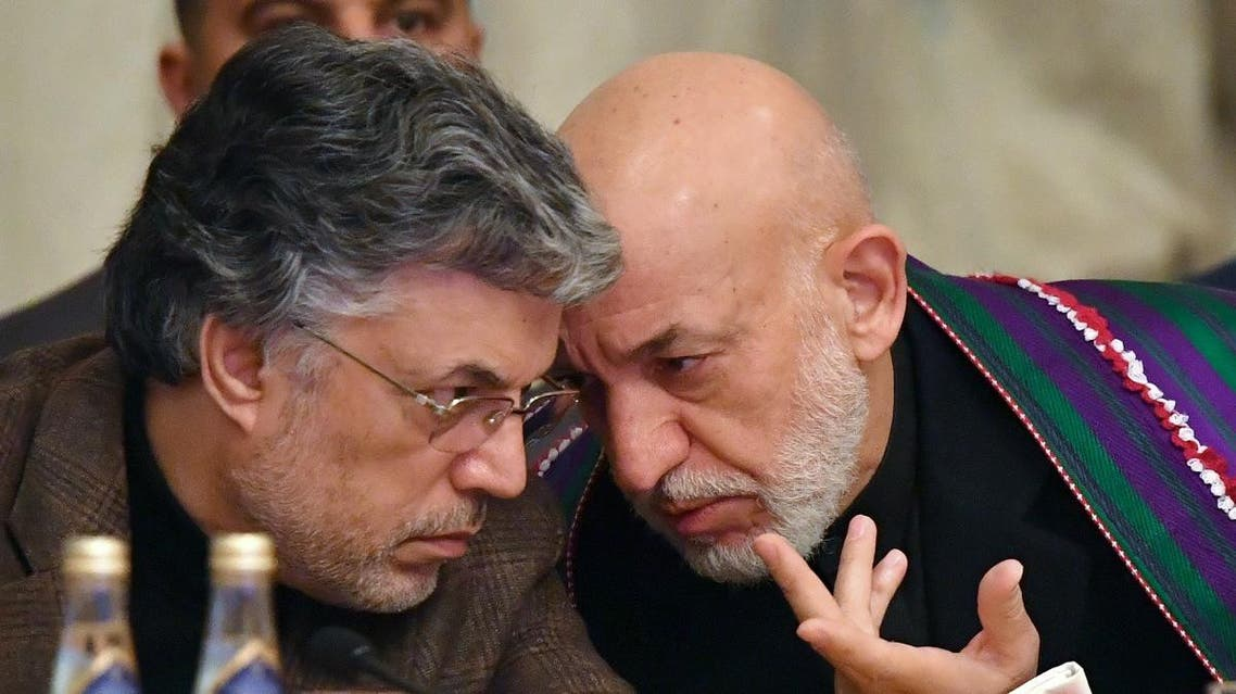 Former Afghan president Hamid Karzai (R) speaks with former vice-President of Afghanistan Mohammad Younus Qanooni during the opening of the two-day talks of the Taliban and Afghan opposition representatives at the President Hotel in Moscow on February 5, 2019. (Reuters)