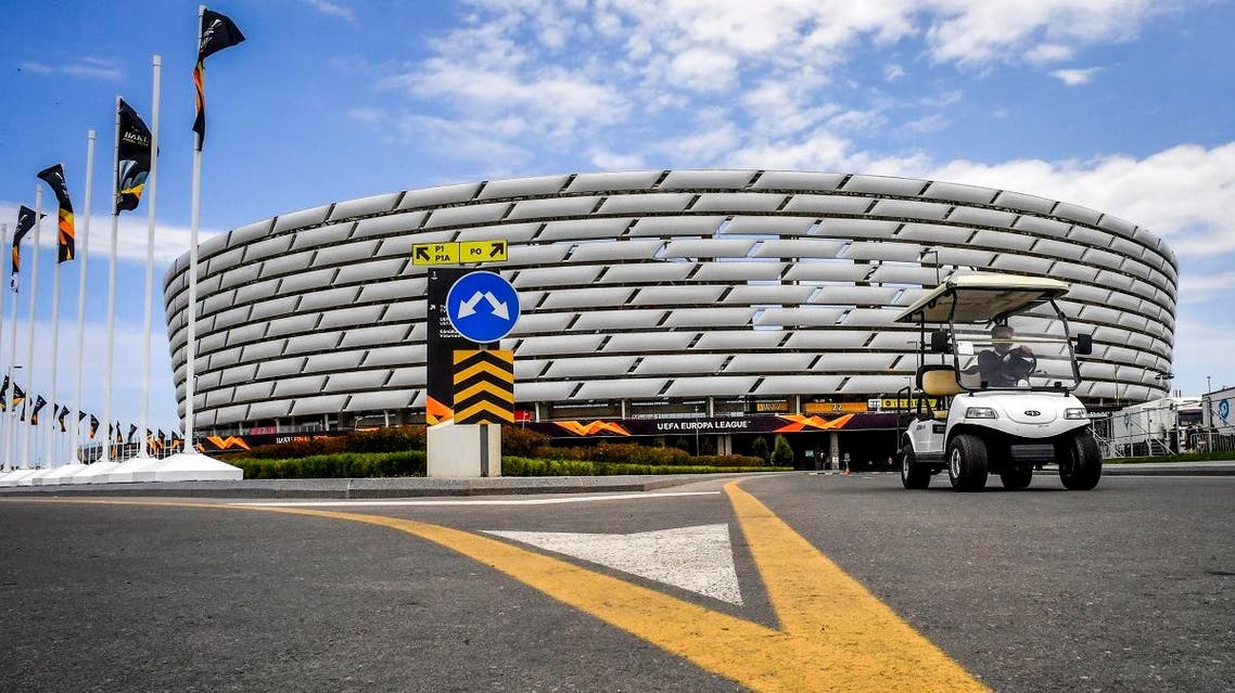 A golf car drives outside the Baku Olympic stadium on May 27, 2019 on the eve of the UEFA Europa league final match between Arsenal and Chelsea, in Baku, Azerbaijan. (AFP)