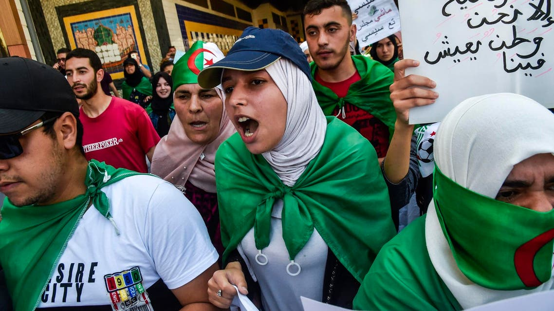Algerian students draped in national flags shout slogans as they take part in a demonstration in Algiers on May 28, 2019. (AFP)