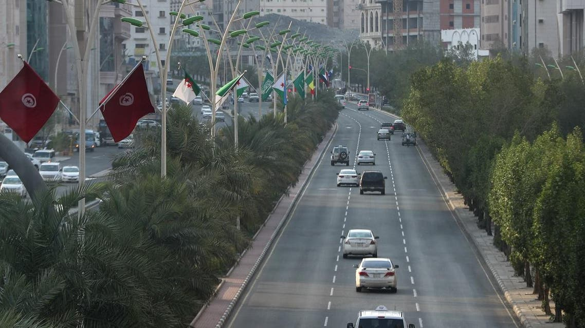 Flags from different countries are pictured in the Saudi holy city of Mecca ahead of the upcoming twin summits of the Arab League and of the Gulf Cooperation Council, on May 27, 2019. Bandar ALDANDANI / AFP