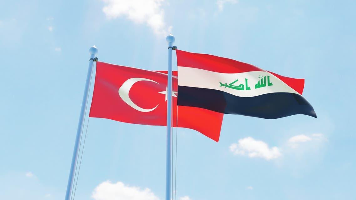 Iraq and Turkey two flags together textile cloth fabric texture - Stock image