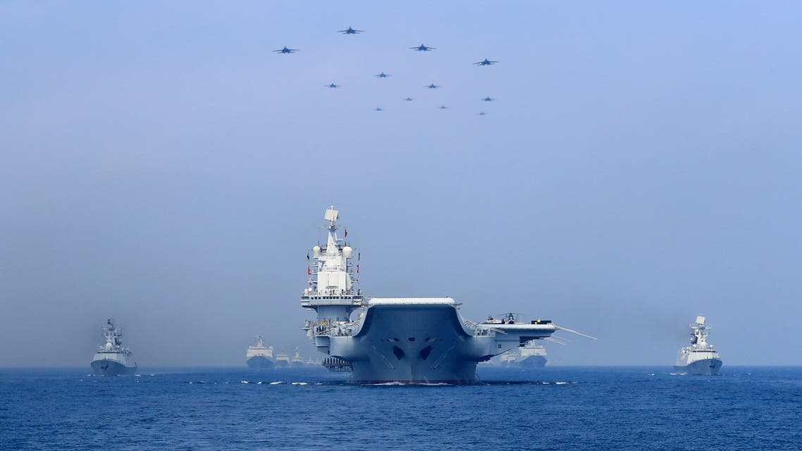 FILE PHOTO - Warships and fighter jets of the Chinese People's Liberation Army (PLA) Navy take part in a military display in the South China Sea April 12, 2018. To match Special Report CHINA-ARMY/NAVY REUTERS/Stringer/File Photo ATTENTION EDITORS - THIS IMAGE WAS PROVIDED BY A THIRD PARTY. CHINA OUT.