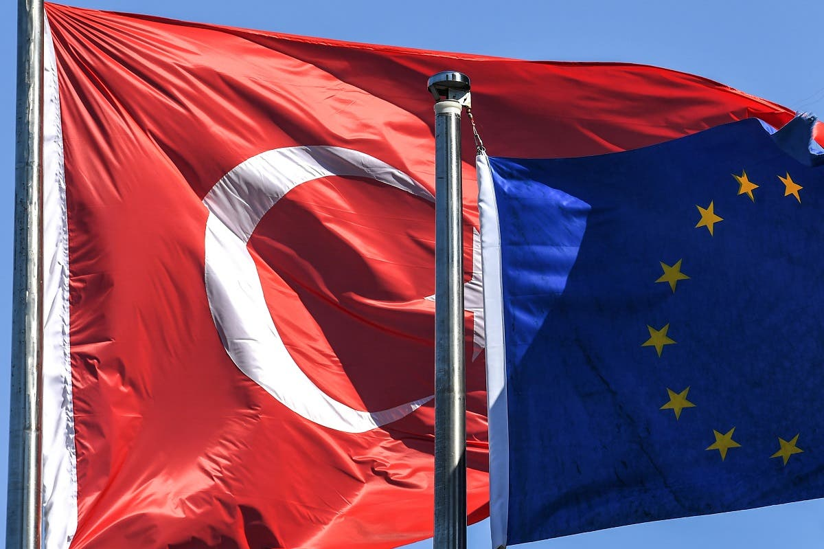Turkish flag and European Union's flag float in the wind at the financial and business district Maslak on August 15, 2018 in Istanbul. (AFP)