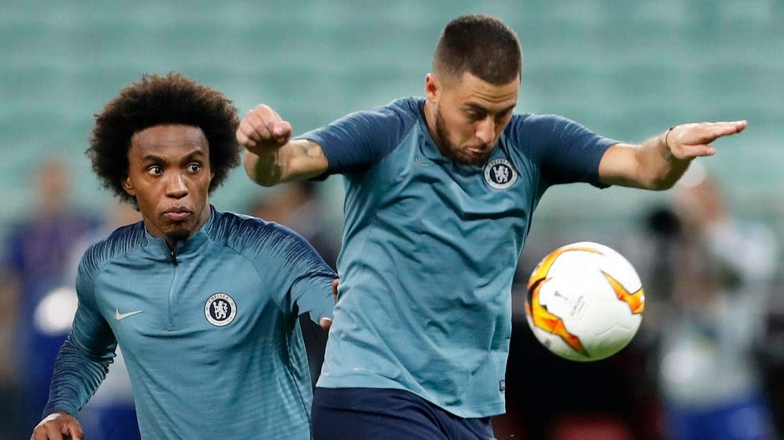 Chelsea's Eden Hazard controls the ball in front of teammate Willian during a soccer training session at the Olympic stadium in Baku, Azerbaijan, Tuesday May 28, 2019. (AP)