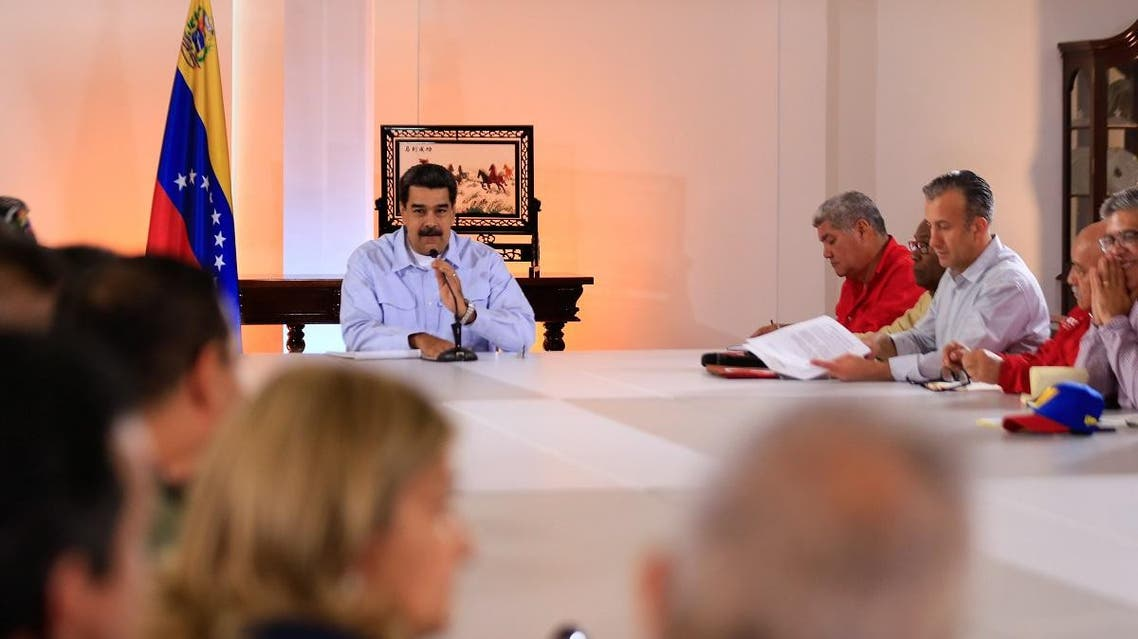 Venezuela's President Nicolas Maduro (C) speaking during a meeting with members of his cabinet at the Miraflores Palace in Caracas, Venezuela on May 27, 2019. (AFP)