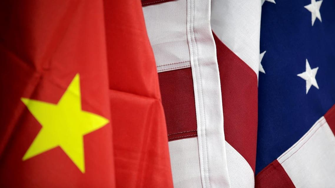 Flags of US and China are displayed at American International Chamber of Commerce (AICC)'s booth during China International Fair for Trade in Services in Beijing, China, May 28, 2019. (Reuters)
