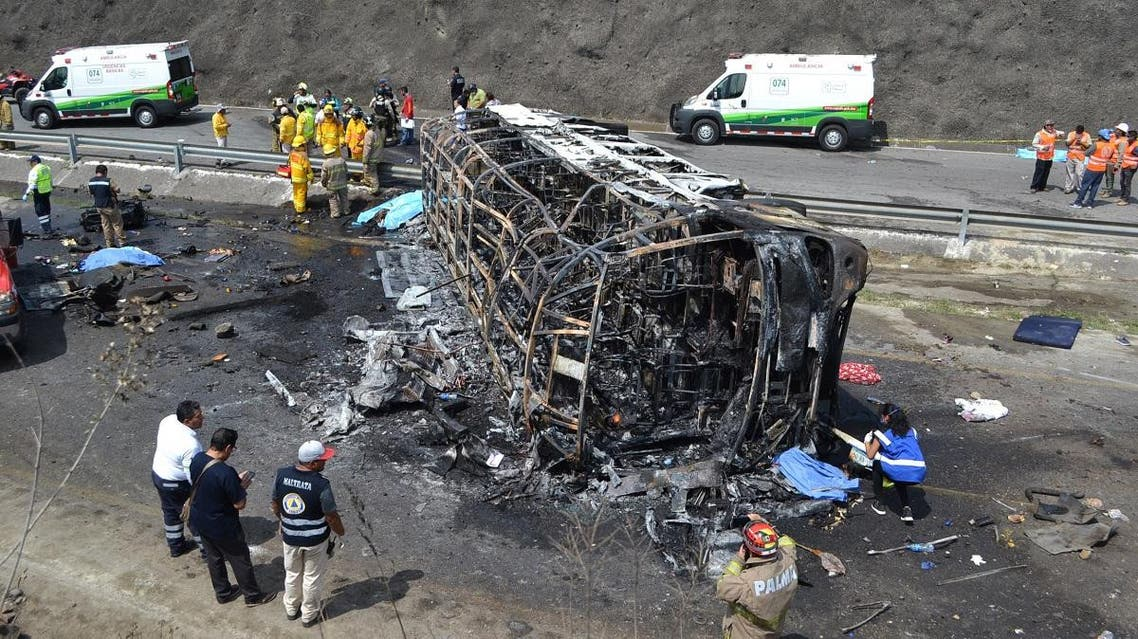 Rescue personal work at the site of a road accident in Coatzacoalcos, state of Veracruz, Mexico on May 29, 2019. (AFP)