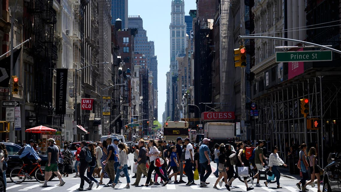 People pass Broadway on a sunny day May 18, 2019 in New York City. (AFP)