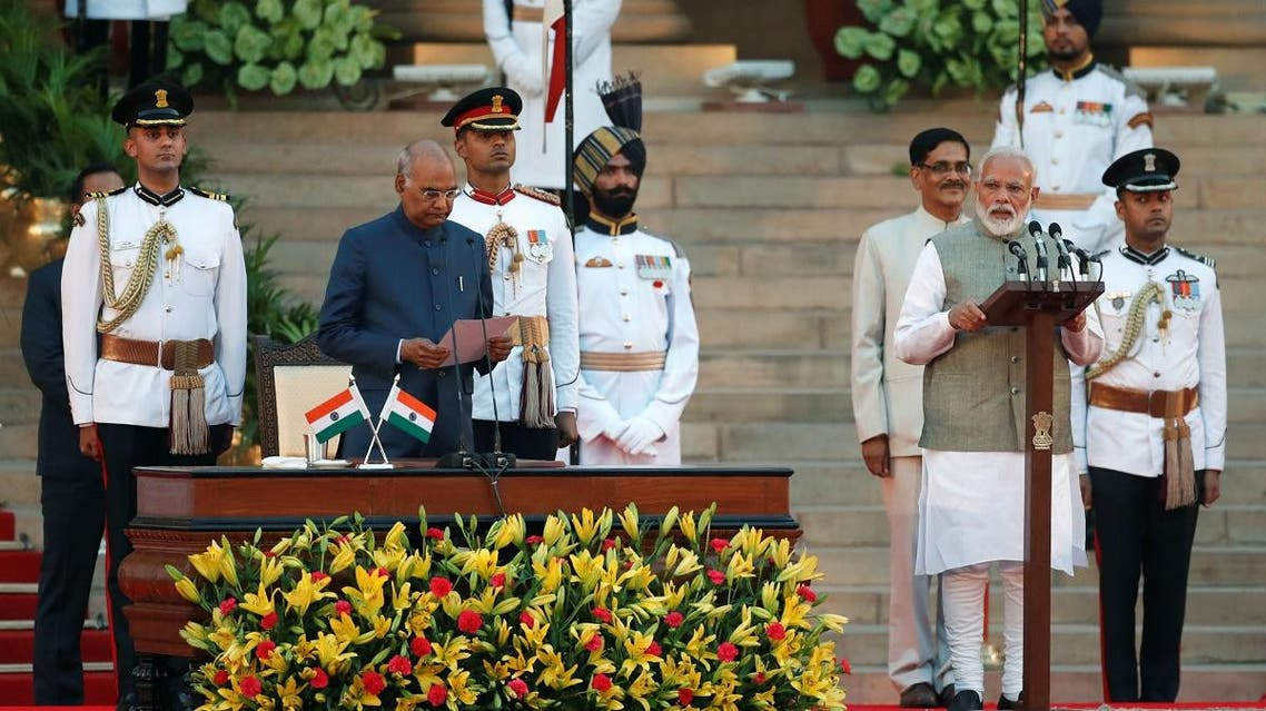 India's President Ram Nath Kovind administers oath of Prime Minister Narendra Modi during a swearing-in ceremony at the presidential palace in New Delhi on May 30, 2019. (Reuters)