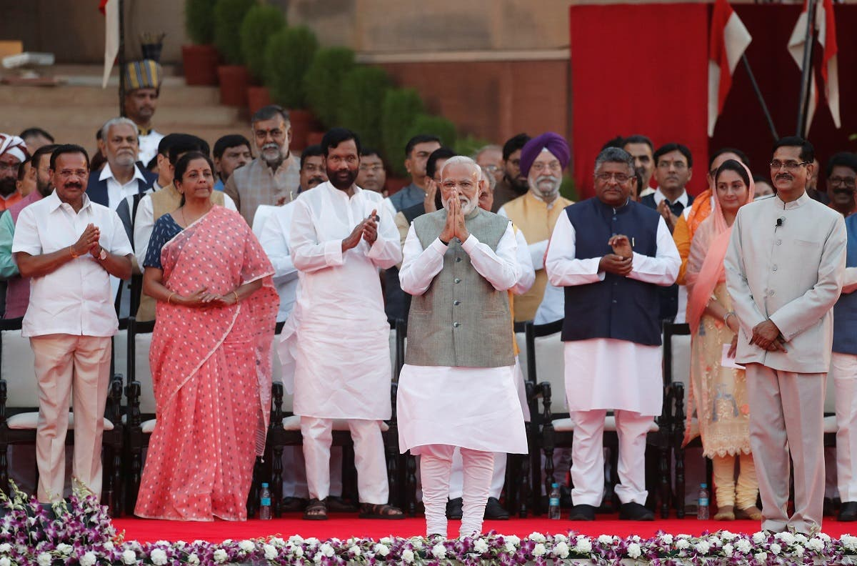 India's Prime Minister Narendra Modi gestures towards supporters after his oath during a swearing-in ceremony at the presidential palace in New Delhi, India May 30, 2019. (Reuters)