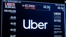 Uber shares skid as losses widen