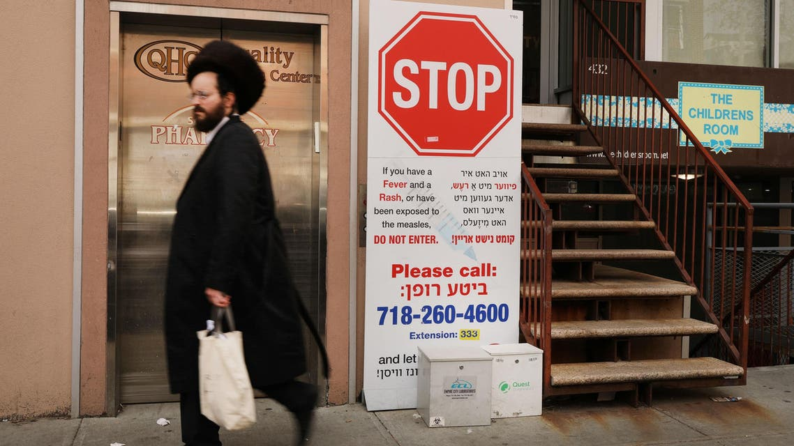 A sign warns people of measles in the ultra-Orthodox Jewish community in Williamsburg on April 19, 2019 in New York City. (AFP)