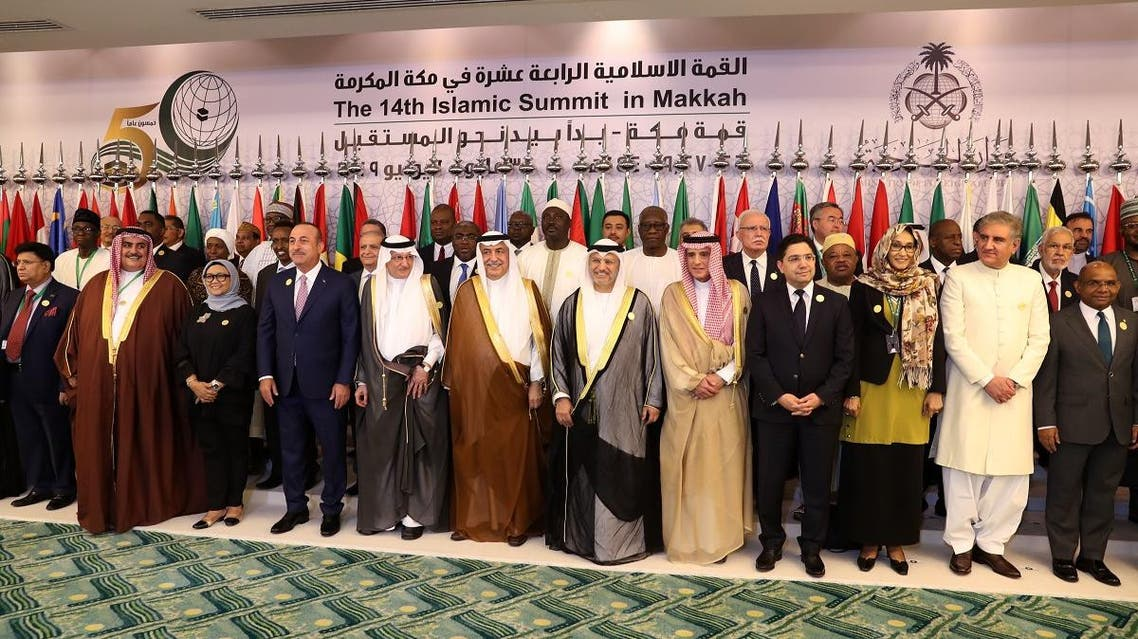 Family picture during a meeting of the OIC and Arab League member states' foreign ministers in Jeddah on May 30, 2019, ahead of the Gulf, Arab, and Islamic summits. (AFP)