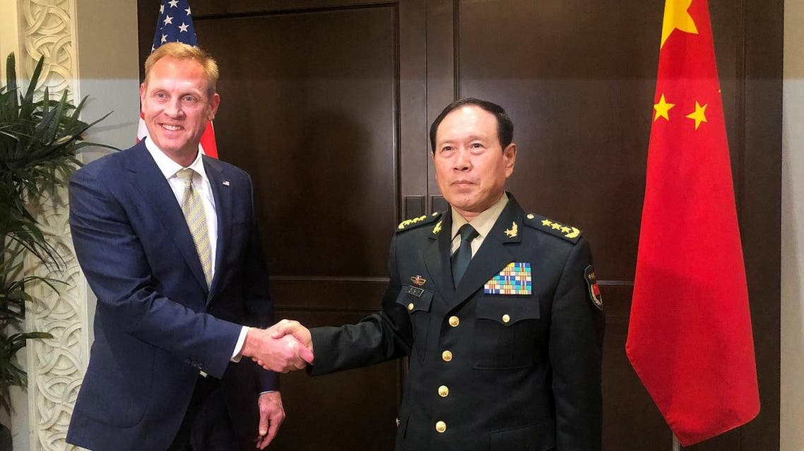 Acting U.S. Defense Secretary Patrick Shanahan and Chinese Defense Minister Wei Fenghe meet before the start of their meeting in Singapore on the sidelines of the Shangri-La dialogue on May 31, 2019. (Reuters)