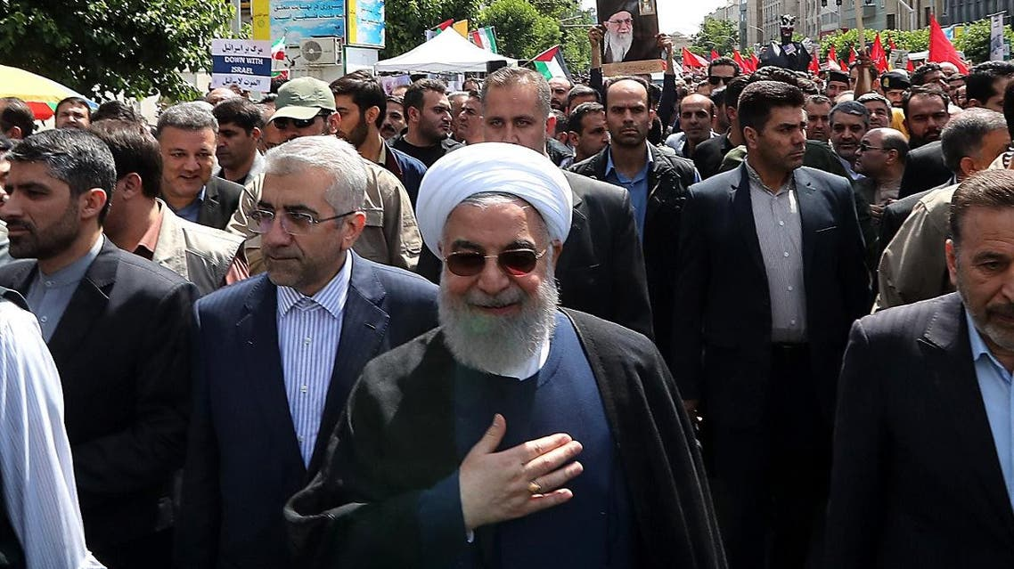 Iranian President Hassan Rouhani attending a parade marking al-Quds (Jerusalem) International Day in Tehran on May 31, 2019. (AFP)