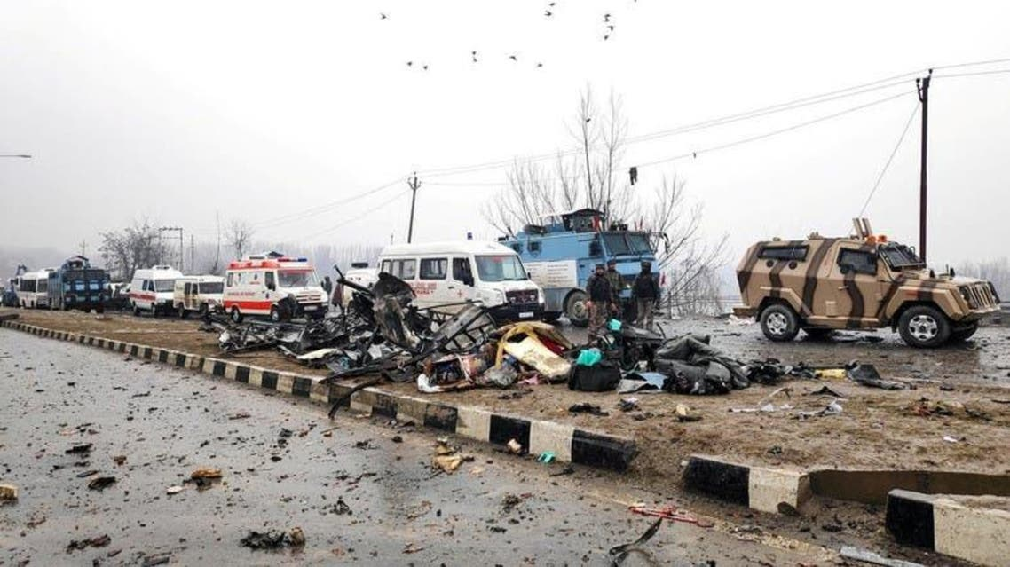 Indian soldiers examine the debris after an explosion in Lethpora in south Kashmir's Pulwama district on February 14, 2019. (Reuters)