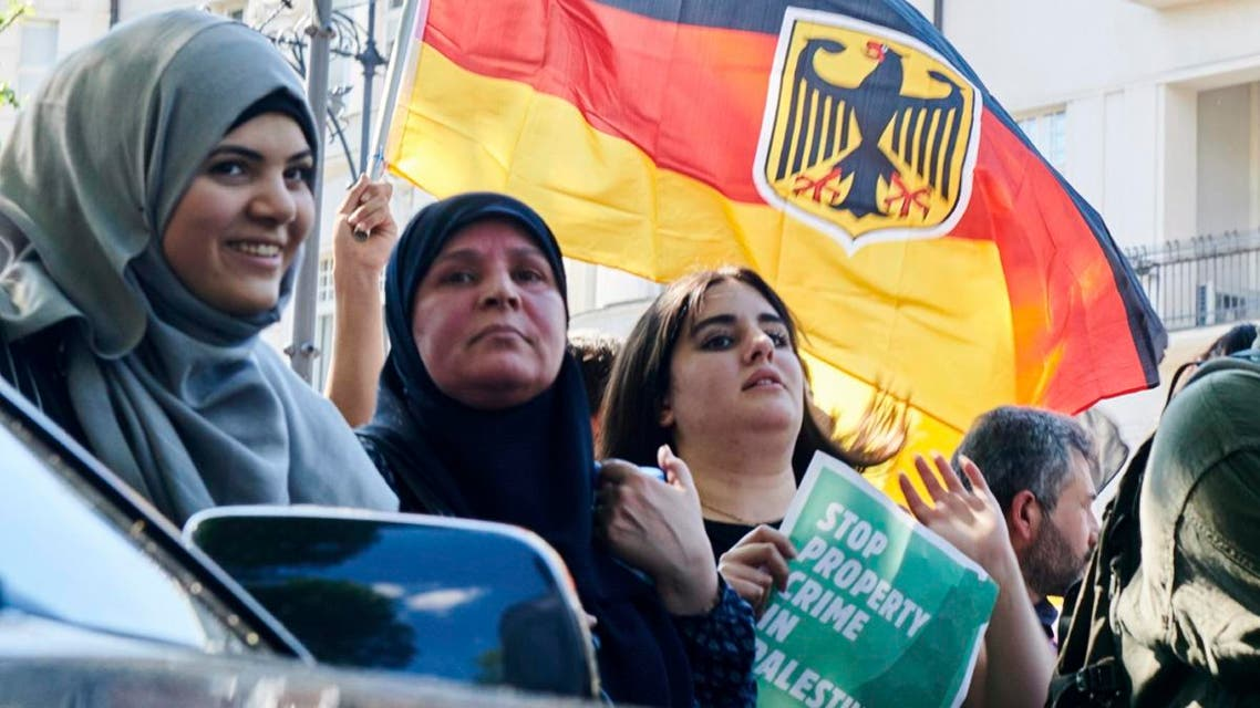 Participants wave a German flag during an anti-Israeli al-Quds demonstration in Berlin, Germany Saturday June 1, 2019. (AP)