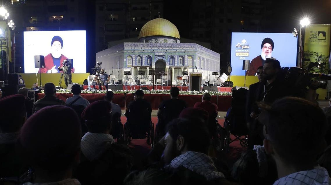 Nasrallah, transmitted on two large screens with a replica of the Dome of the Rock mosque, during the al-Quds (Jerusalem) International Day, in a southern suburb of the capital Beirut on May 31, 2019. (AFP)