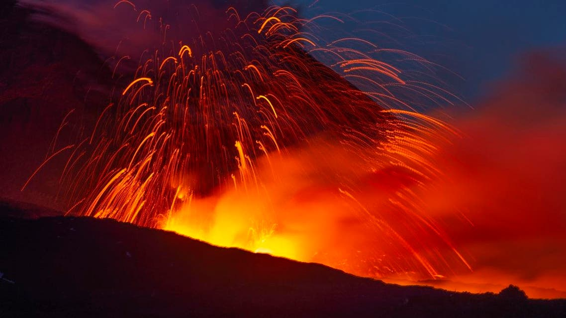 Mount Etna has roared back into spectacular volcanic action from Thursday morning, sending up plumes of ash and spewing lava. (AP)