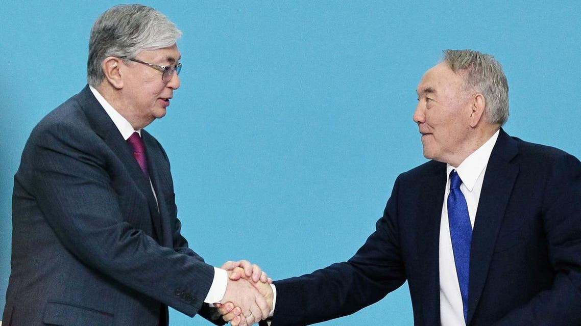 Long-time president Nursultan Nazarbayev (R) stood down in March and allowed loyalist diplomat Kassym-Jomart Tokayev (L) to succeed him. (File photo: AFP)