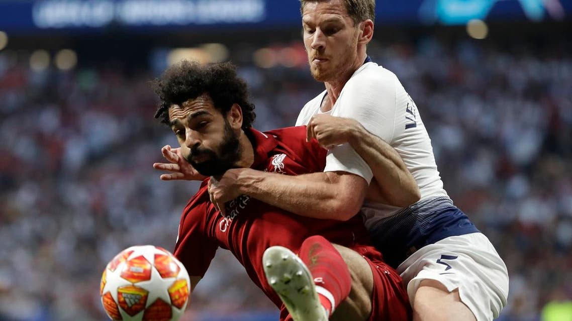 Liverpool's Mohamed Salah (left) fights for the ball with Tottenham's Jan Vertonghen during the Champions League final soccer match at the Wanda Metropolitano Stadium in Madrid on June 1, 2019. (AP)