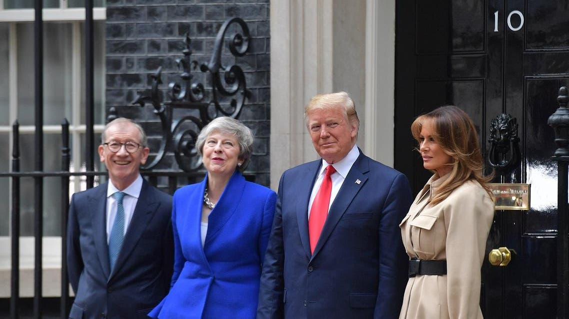 UK's PM May and her husband Philip (L) pose with US President Trump and wife Melania outside 10 Downing Street in London on June 4, 2019. (AFP)