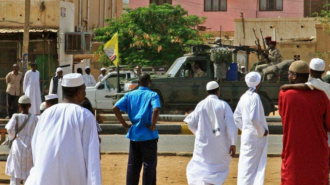 Members of Sudan's security forces patrol as Muslim worshippers attend Eid al-Fitr prayers marking the end of the holy fasting month of Ramadan on June 5, 2019 in Omdurman, just across the Nile from the capital Khartoum. (AFP)