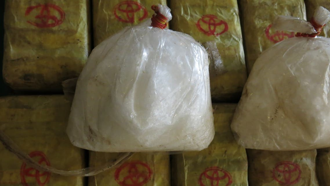 In this Feb. 15, 2013 photo, two bags of crystal meth and packets of methamphetamine pills trafficked from Myanmar are displayed at a press conference in Bangkok after police seized nearly 2 million tablets and 20 kilograms of crstyal meth. Seizures of methamphetamines reached record highs in East and Southeast Asia in 2012, with Myanmar retaining its status as a major supplier of the illicit drugs, the United Nations said Friday, Nov. 8, 2013. (AP Photo/Jocelyn Gecker)