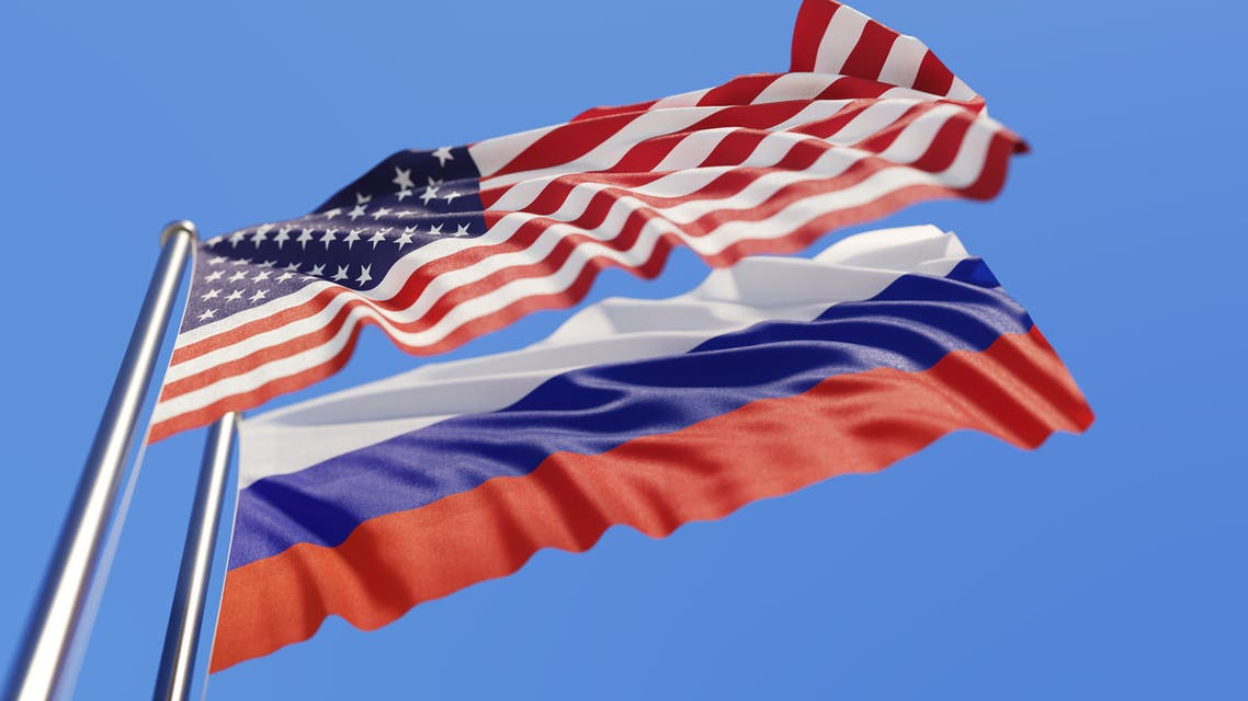 American And Russian Flags Waving With Wind On Blue Sky - Stock image