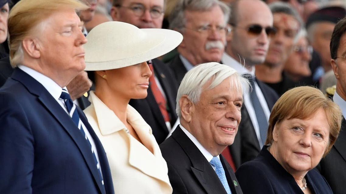 US President Donald Trump, first lady Melania Trump, Greek President Prokopis Pavlopoulos and German Chancellor Angela Merkel attend an event to commemorate the 75th anniversary of D-Day, in Portsmouth, Britain, on June 5, 2019. (Reuters)