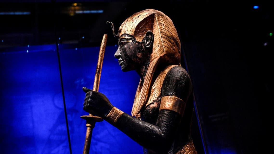 A sculpture depicting Tutankhamun displayed during the exhibition Tutankhamun, Treasures of the Golden Pharaoh at La Villette, in Paris on March 21, 2019. (AFP)