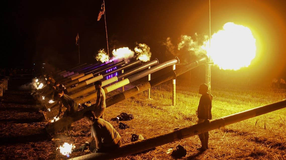 Steel cannons being fired to mark the beginning of Eid celebrations in Kuala Kangsar in the early morning of June 5, 2019. (AFP)