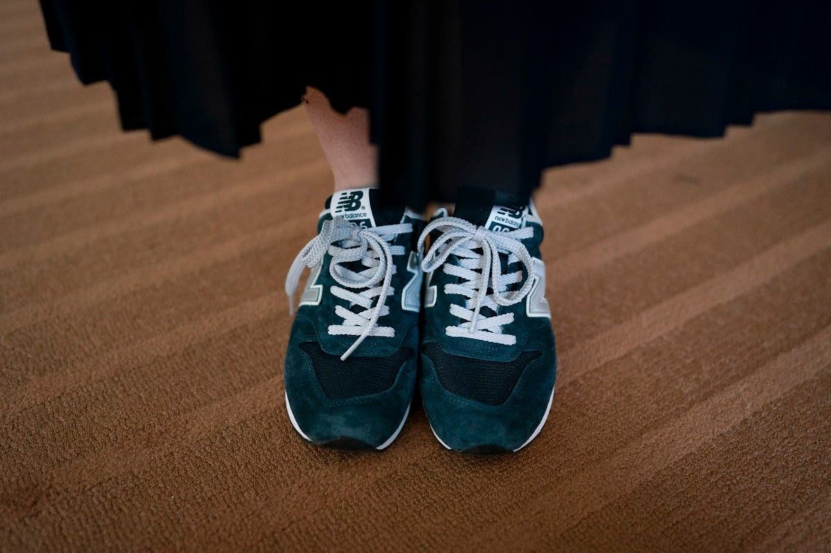 Yumi Ishikawa, a 32-year-old actress and writer, wears a pair of blue New Balance sneakers while posing for photos Wednesday, June 5, 2019, in Tokyo. (AP)