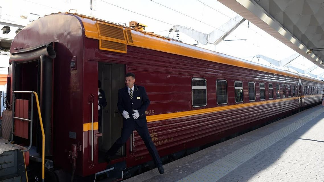 A train conductor steps down from a car of the first tourist train passing through Russia's Arctic regions to Norway as it prepares to leave Saint Petersburg for a 11-day trip with 91 passengers on board, June 5, 2019. (AFP)