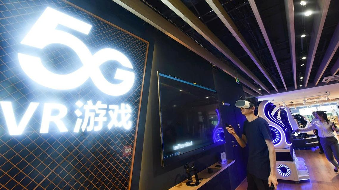 A man plays a 5G virtual reality (VR) game at a 5G store in Hangzhou, China's Zhejiang province on June 3, 2019. (AFP)