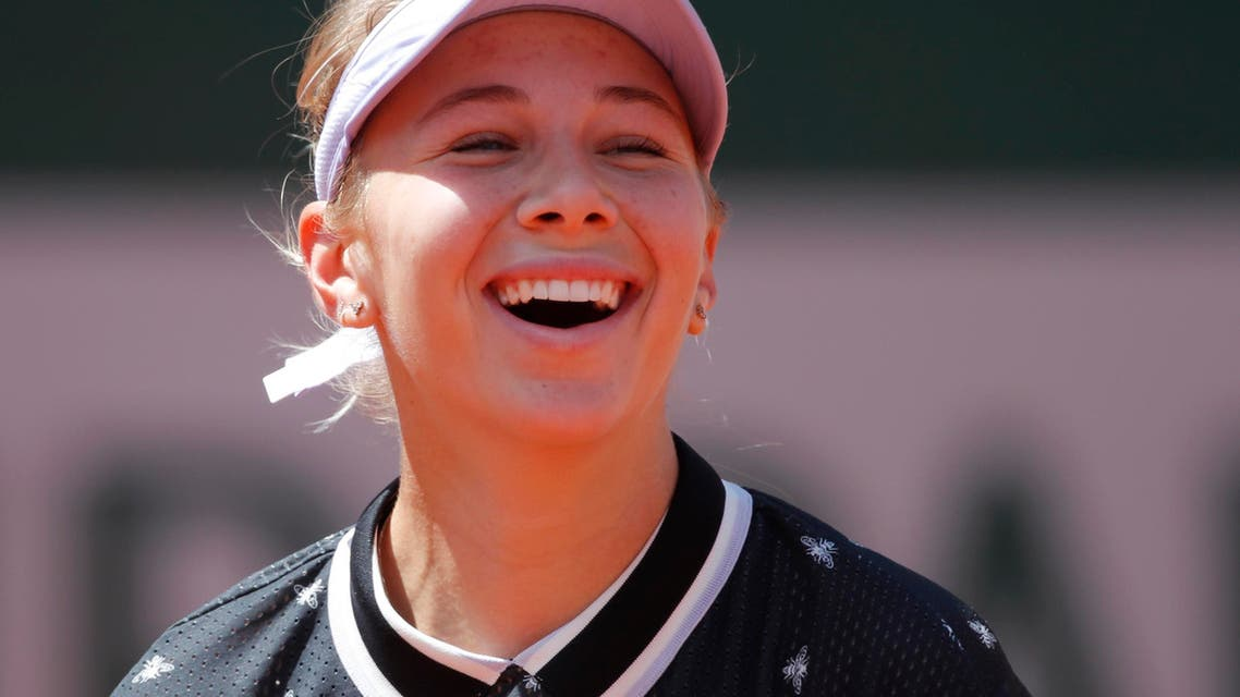 Amanda Anisimova of the US celebrates after her quarterfinal match against Simona Halep at the quarter-final of the French Open on June 6, 2019. (Reuters)