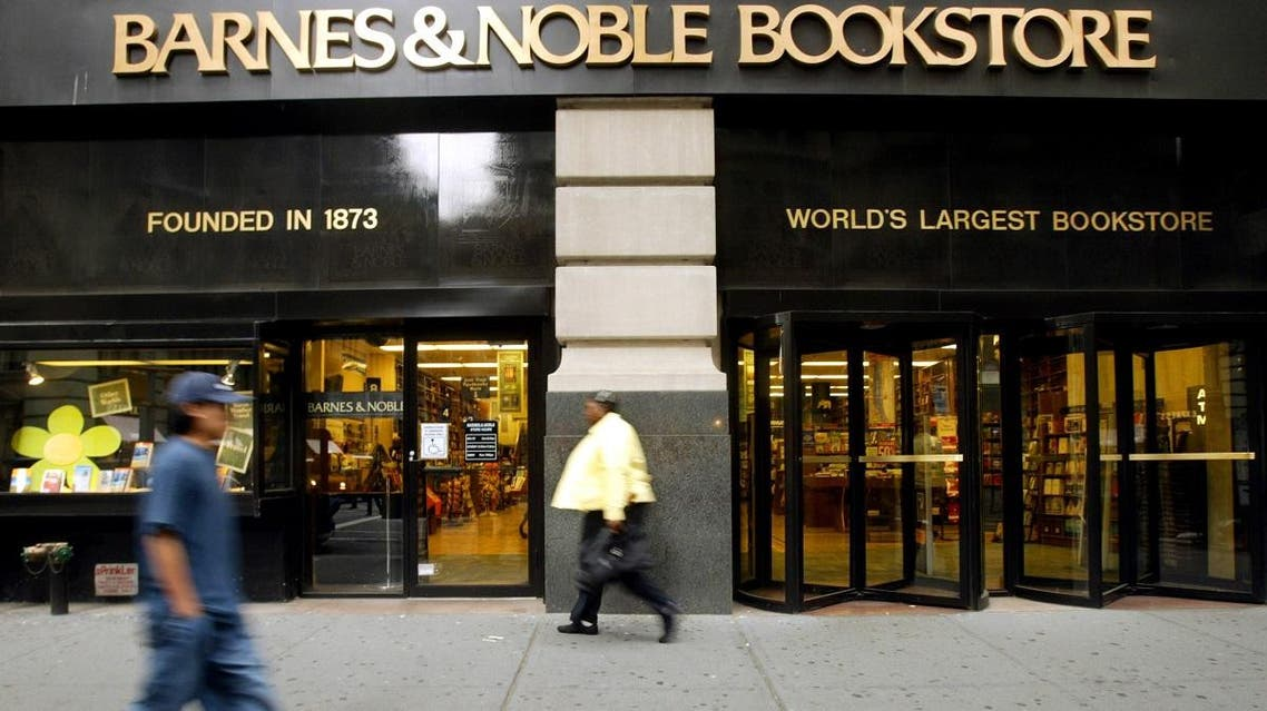 Pedestrians walk past a Barnes and Noble bookstore on Fifth Ave, Monday, May 16, 2005, in New York.