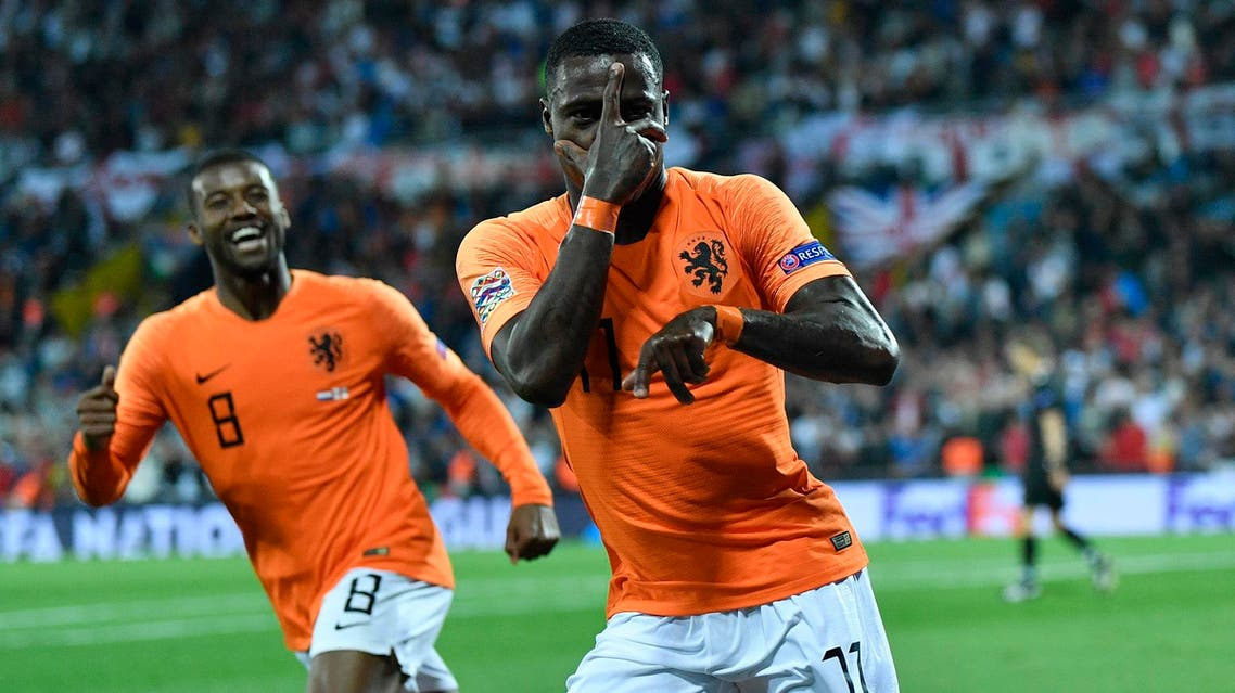 Netherlands' Quincy Promes, right, celebrates after scoring his side's second goal during the match against England in Guimaraes on June 6, 2019. (AP)