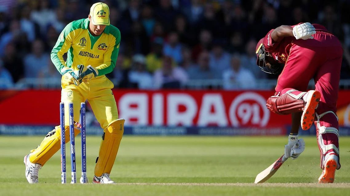 West Indies' Jason Holder completes a run as Australia's Alex Carey attempts to stump him. (Reuters)