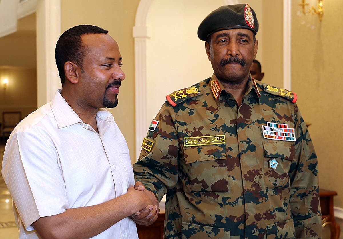 Ethiopia's Prime Minister Abiy Ahmed (L) meets with the chief of Sudan's ruling military council General Abdel Fattah al-Burhan in Khartoum on June 7, 2019. (AFP)